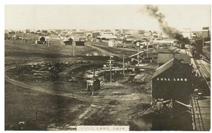 RAILWAY DEPOT REAL PHOTO POSTCARD GULL LAKE SASKATCHEWAN & TOWN SIGHT TRAIN SMOKE DEPOT SIGN RUMSEY PHOTO CANADA