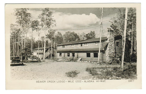 ALASKA HIGHWAY.  RPPC POSTCARD. BEAVER CREEK LODGE. MILE 120. CANADA