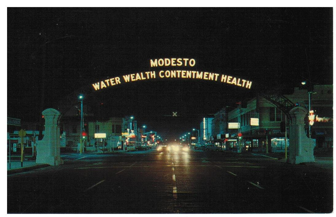 "MODESTO. CA. CHROME POSTCARD. ARCH: ""MODESTO WATER WEALTH CONTENTMENT HEALTH"". UNITED STATES."