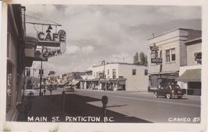 BC. Penticton. RPPC. Postcard. Main Street. Clouds. Shadows. Bicycles. Automobiles. British Columbia, Canada