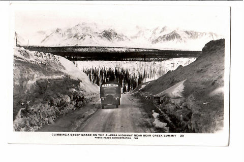 THE 1940'S BUS RPPC POSTCARD ON THE ALASKA HIGHWAY NEAR BEAR SUMMIT