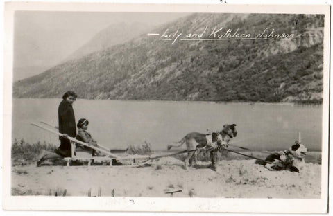 LILY AND KATHLEEN JOHNSON WITH DOG SLED TEAM RPPC POSTCARD B.C. GOWEN & SUTTON