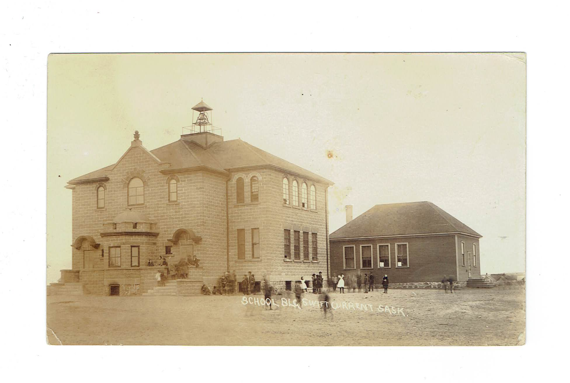 Swift Current, SK. RPPC Postcard. School Building With Teachers And Students. Canada.