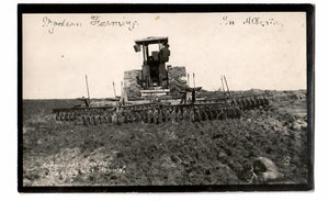 MODERN FARMING IN AB. ALBERTA RPPC POSTCARD 1920 BY J.H. BROWN COPYRIGHT CANADA. TRACTOR AND PLOUGH