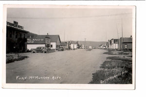 FORT MCMURRAY AB. ALBERTA RPPC POSTCARD STREET SCENE WITH 1930'S CARS AUTOMOBILES SUTHERLAND PHOTO