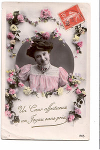 GREETING POSTCARD RPPC FROM FRANCE WITH A SMILE OF A YOUNG WOMAN. STAMP ON FRONT AS USUAL PRACTICE IN FRANCE