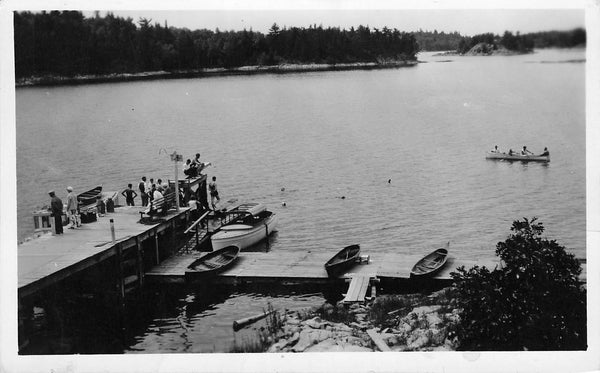 Kenora, ON. Swimmers And Boats At Dock. RPPC Postcard. Canada