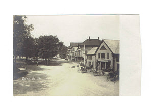 Cornish, ME. Main Street With Storefronts, Horses And Wagons. 1900's. RPPC Postcard. USA