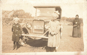 1920-25 Children Pose With Mom In Front Of Automobile. Vintage RPPC Postcard