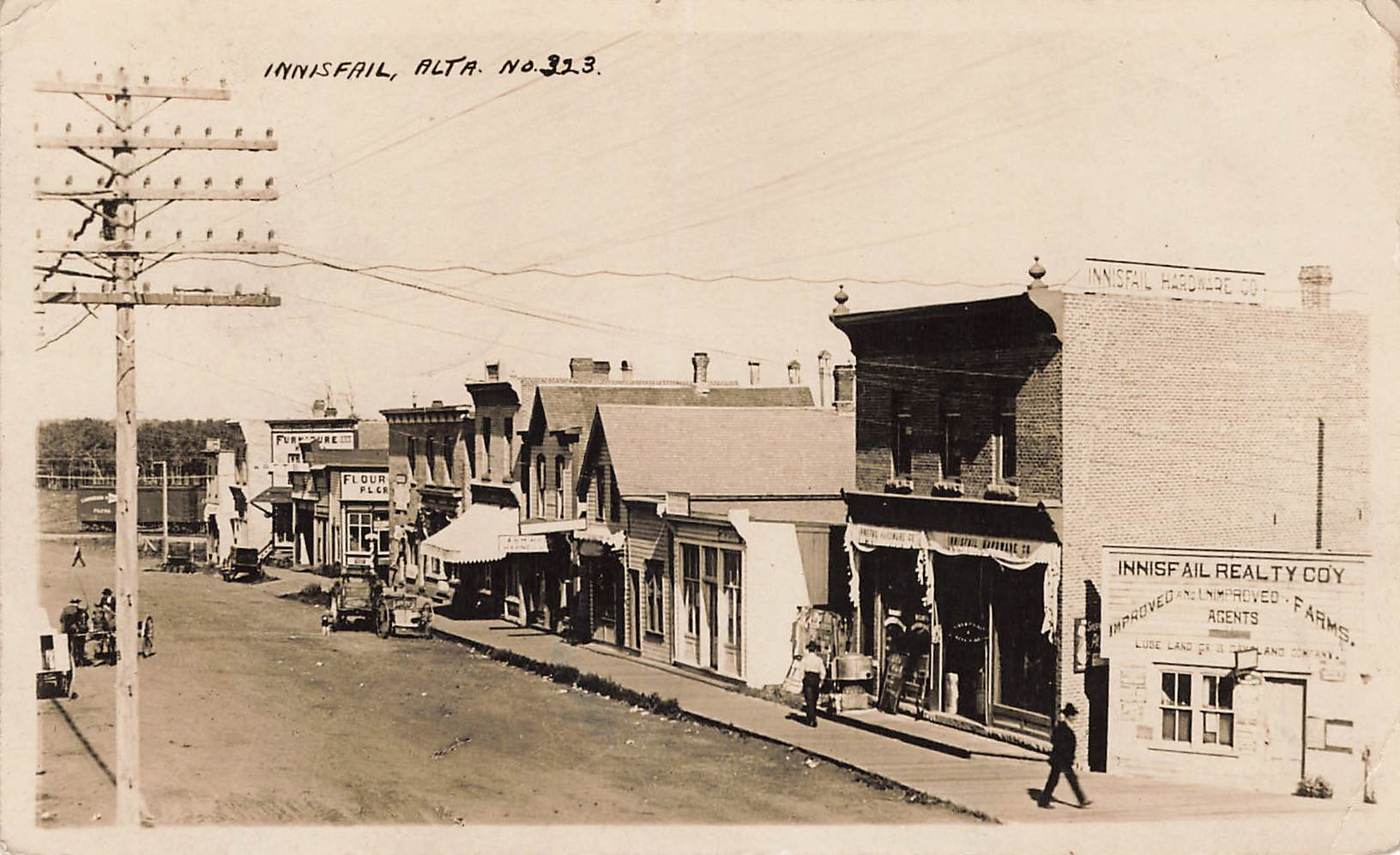 Innisfail, AB. Street Scene With Storefronts. RPPC Postcard. Canada