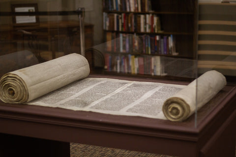 Image of a Torah being displayed at Trinity International University