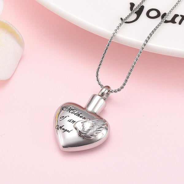"Cremation Necklace - Silver Heart Shaped Cremation Urn Necklace With Angel Wings Engraved ""Mother Of An Angel"""