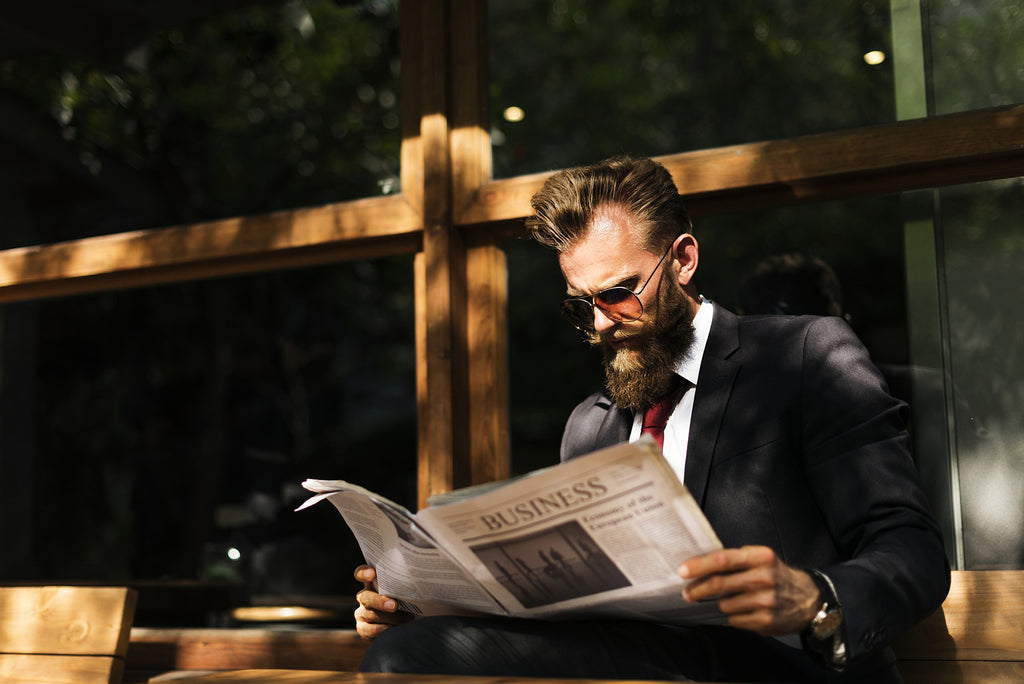 Bearded Man Reading Newspaper | 4 Top Trending Hairstyles For Guys With Beards in 2019