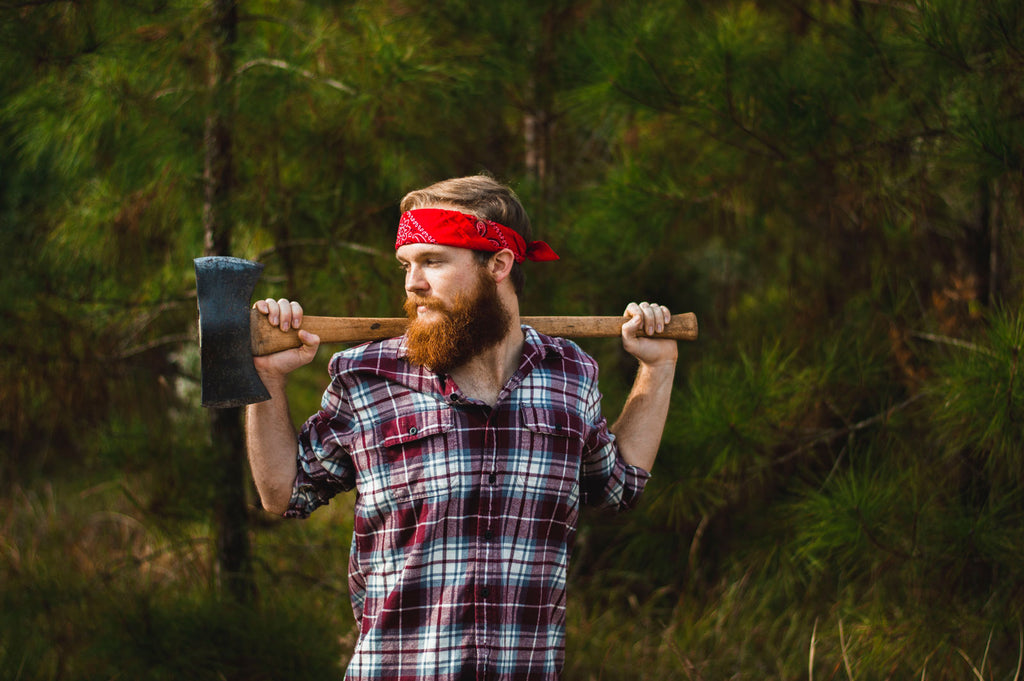 Bearded Man Holding an Axe | What Are the Best Beard Care Products for Men?