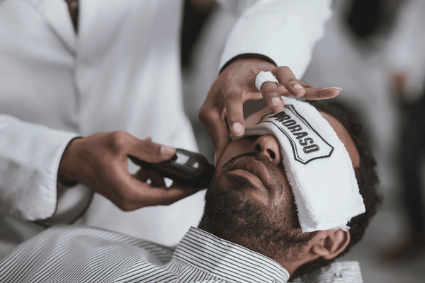 Man Trimming Beard | Why An Affordable Beard Trimmer Will Get The Job Done