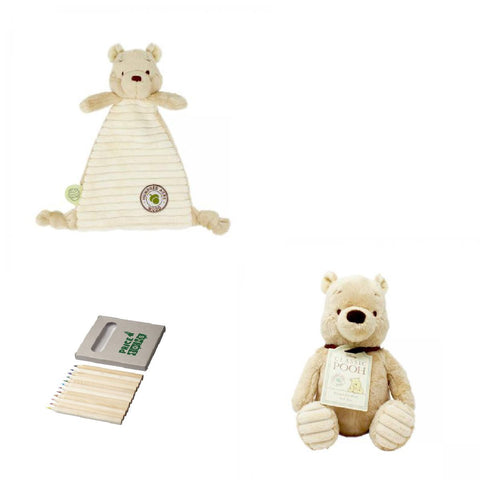 Image of Pooh bear soft toy and comforter