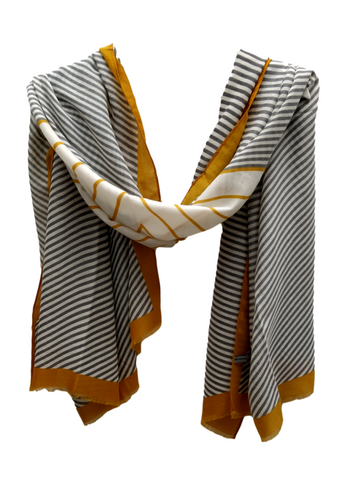 A medium weight scarf with grey and mustard lines on a cream background