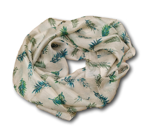 A beige silk scarf with a design of ferns