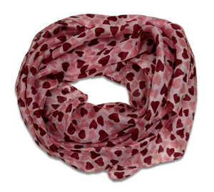 A silk scarf with a design of pink hearts