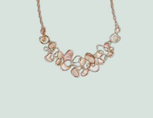 N073 Gold and Pink Swirling Necklace