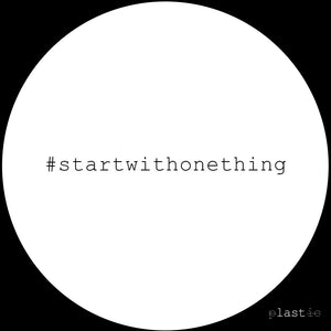 White circle on a black background with #startwithonething in the middle.