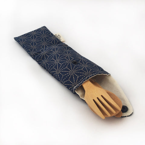 Cutlery pouch open with bamboo cutlery inside