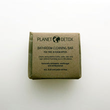 plastic free solid bathroom cleaning bar. packaged in brown craft paper