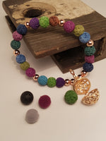 MULTI-COLORED LAVA STONE BEAD BRACELET WITH ESSENTIAL OIL BEAD REFILL AND CHARM