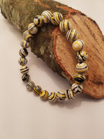 SWIRL BEADED BRACELET YELLOW BLACK AND WHITE
