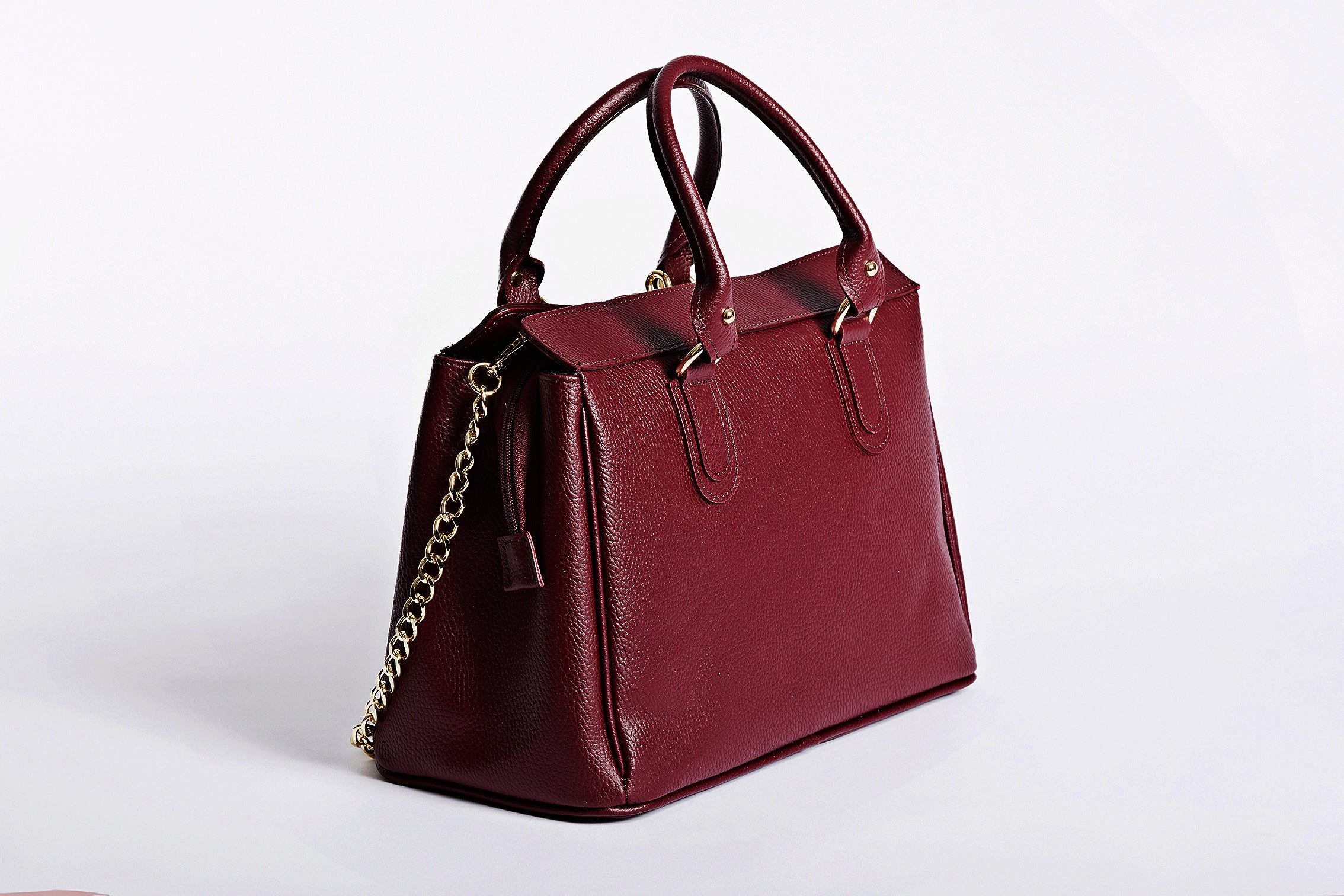 Ruby red Versatile bag in trunk. Stylish work and everyday handbag