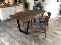 Handmade dining table made from walnut and steel metal base finished in black