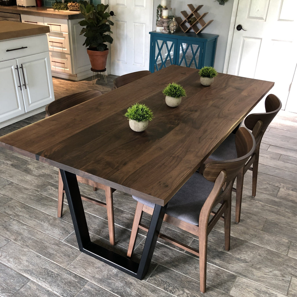 Dining table handmade out of walnut with black metal legs