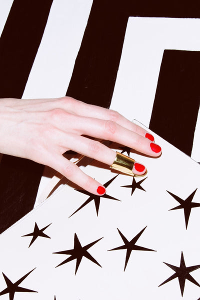 Ann Howell Bullard wearing Sterling King gold statement ring with black and white background