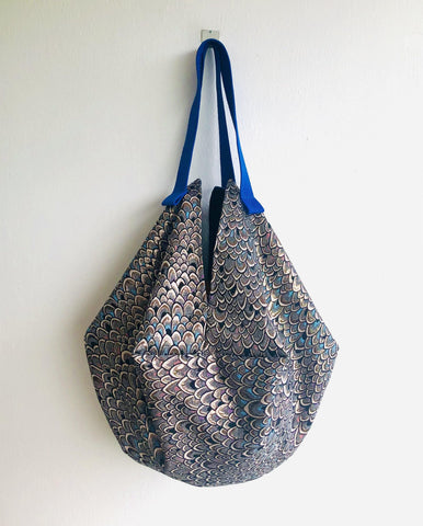 Sac origami bag , unique fabric shoulder bag , reversible tote bag | Blue and pink light effect on an art nouveau building