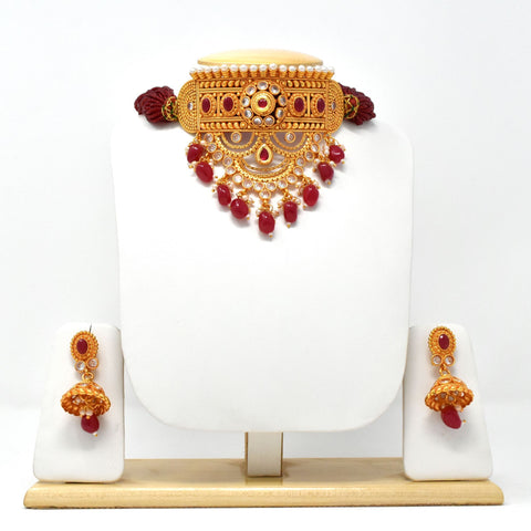 Gold Plated Rajputi Aad studded with Beads and Pearls.