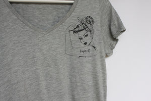 Close up of a grey organic cotton V neck T shirt with a vintage tattoo style lady design with the slogon OWN It on her muscle