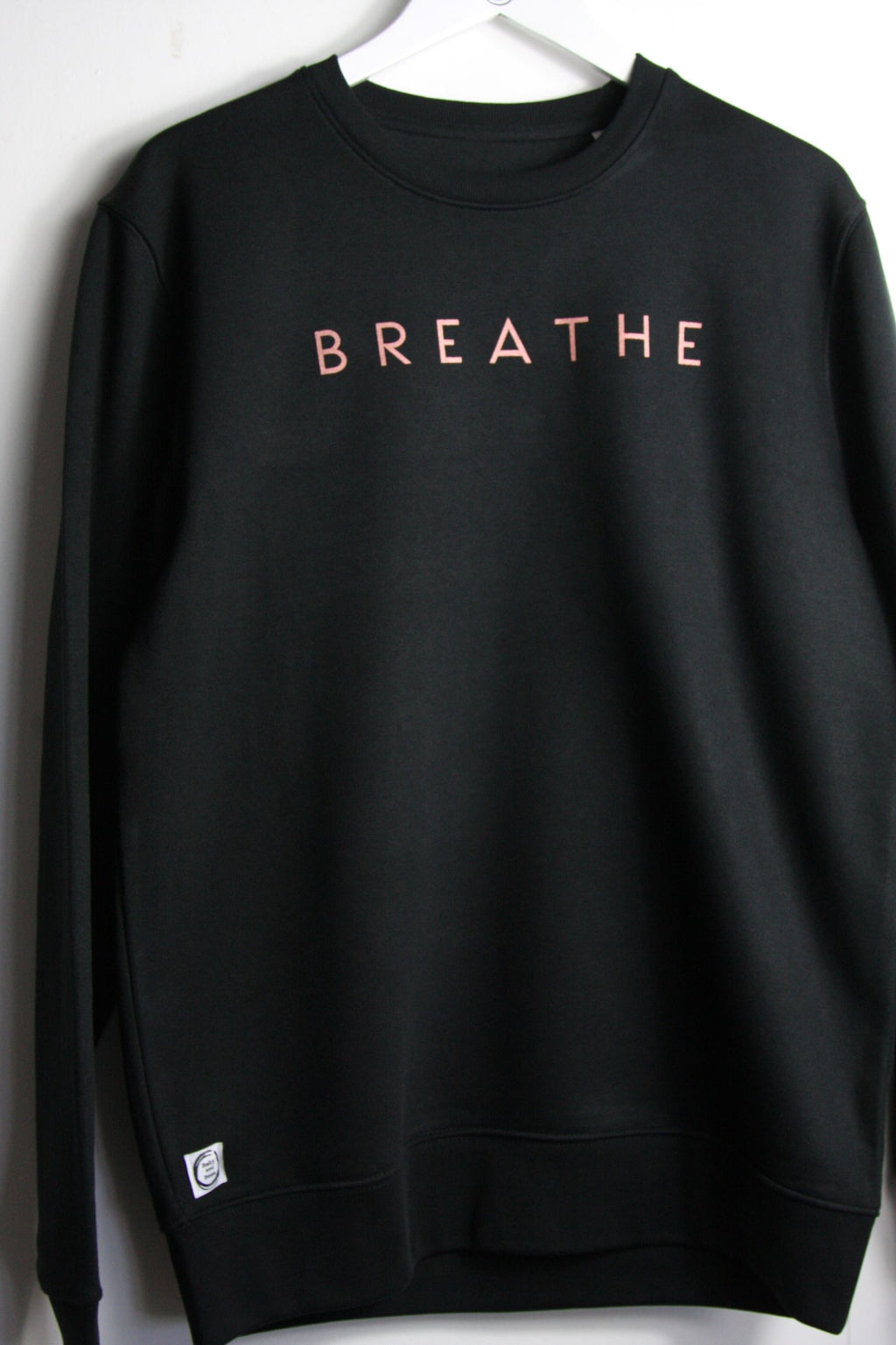 Classic black sweatshirt with BREATHE design printed in copper ink
