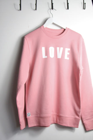 Ladies sweatshirt in pink featuring screenprinted LOVE design in white ink