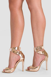 Darla Peep Toe Heel In Gold Patent Faux Leather