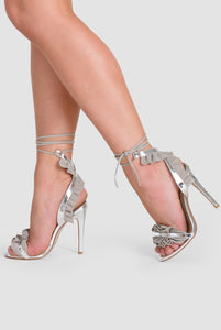 Rhea Lace Up Heels with Grey Ruffle in Silver Patent Faux Leather
