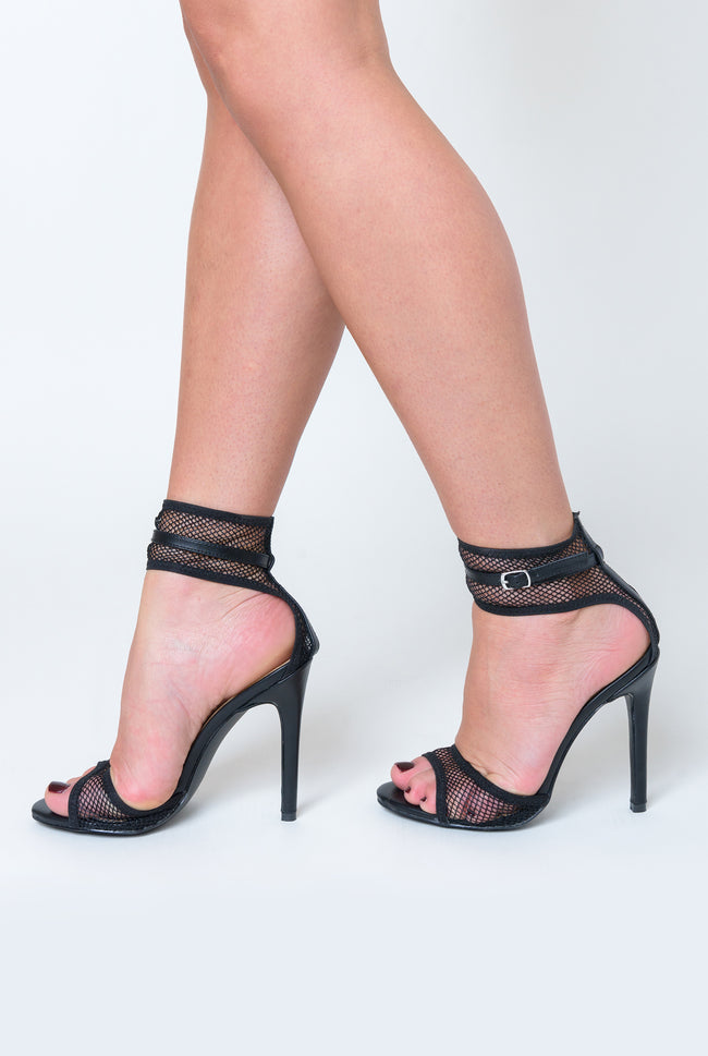 Rita Fishnet Heel In Black Faux Leather