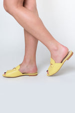 Cleo Peep Toe Flat Mule In Lemon Faux Leather