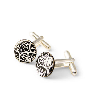 A pair of black cufflinks made from silver, paper and resin by Dittany Rose