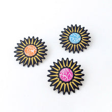 Brightly coloured brooches made by Dittany Rose