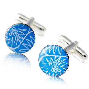 A pair of blue cufflinks handmade in Cambridge, UK, from silver, card and resin