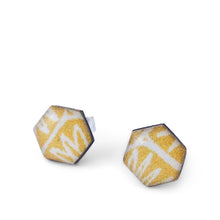 Load image into Gallery viewer, A pair of mustard colour hexagon geometric stud earrings handmade from silver, paper and resin by Dittany Rose