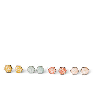 Four pairs of geometric stud earrings handmade from silver, paper and resin by Dittany Rose