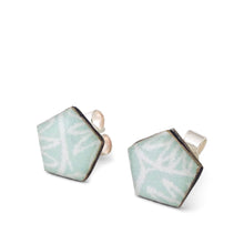 A pair of pale blue geometric pentagon stud earrings handmade from silver, paper and resin by Dittany Rose