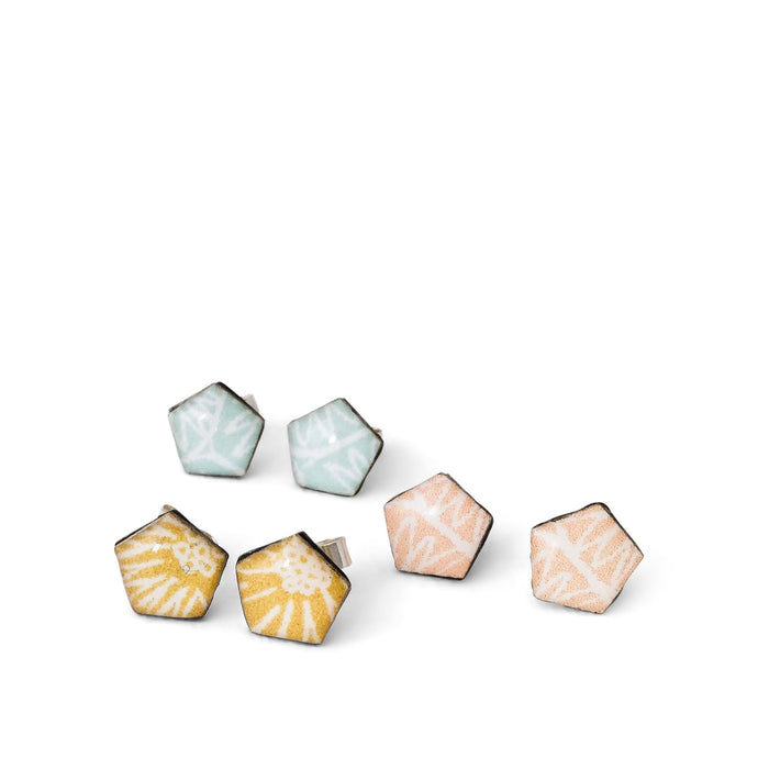Three pairs of geometric pentagon stud earrings handmade from silver, paper and resin by Dittany Rose