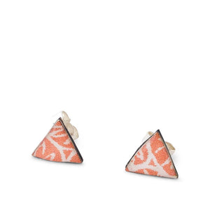A pair of coral colour geometric triangle stud earrings handmade from silver, paper and resin by Dittany Rose